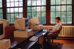 Young Man Sitting at Computer